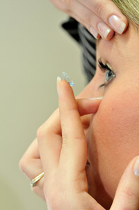 Picture of contact lens being put into eye