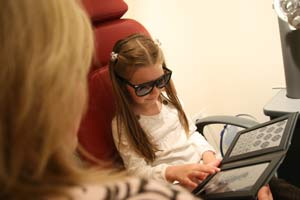 Girl has eye tested at Hayes Opticians